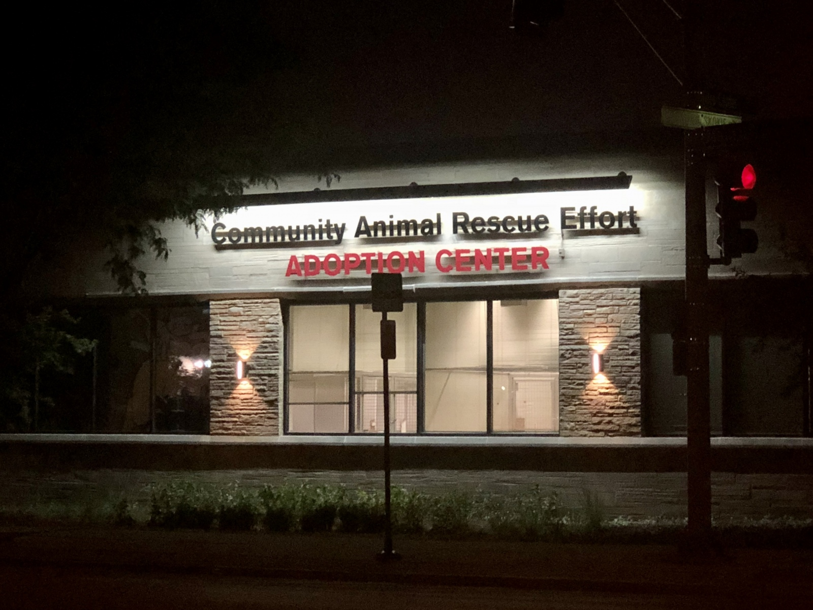 Building Sign Night View - Community Animal Rescue Effort Adoption Center Custom Home. America's Custom Home Builders: New Construction, Remodeling, Restoration Services. Residential and Commercial.