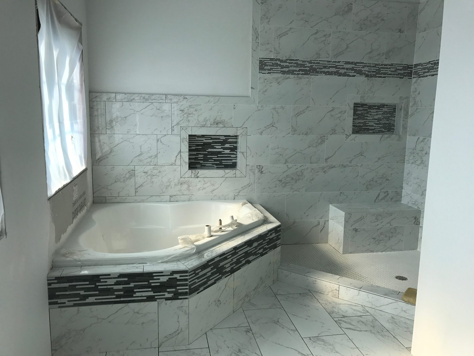 the bathroom tile work has been completed at our custom 11735